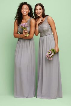 Long grey bridesmaid dresses with sequins create a sophisticated bridal party. Explore more colors and styles at David's Bridal.