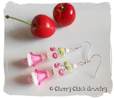 "A new design look for Cherry Chick Jewelry...pastel colored earrings created with etched lampwork glass Cherry beads in shabby chic shades of pink and white polka dots. I've used pink Swarovski crystals, perfectly matching shades of Lucite Flower beads, and vintage glass white flower beads. These ""pastel pretty"" earring cascade down 2 5/8 inches in length. $28"