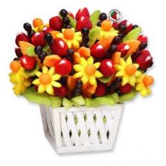 Fresh fruit bouquet with pineapple, cantaloupe, honeydew melon, grapes and strawberries.  Click through for a step by step description