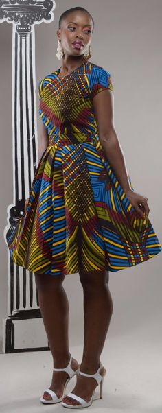 NEW - Dazzle Alice-in-wonderland African print pleated dress by GITA'S PORTAL. BACK BY POPULAR DEMAND in a brand new fabric. This beautiful Alice in Wonderland dress has hints of the It's a playful yet demure dress that's a stunner and bound to fetch African Inspired Fashion, African Print Fashion, Africa Fashion, Fashion Prints, Men's Fashion, African Attire, African Wear, African Women, African Style