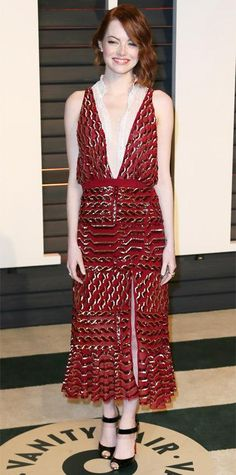 Emma Stone took the plunge for her Oscars after-party look, swapping her beaded chartreuse Elie Saab number for a navel-plunging burgundy lace Altuzarra piece (fresh off the fall 2015 runway) with black peep-toe sandals.