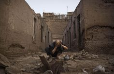 A Uighur man washes himself before prayers next to abandoned traditional houses set to be demolished by authorities to make way for new homes on July 2014 in old Kashgar. Make Way, Traditional House, Beijing, Muslim, Around The Worlds, Community, China, Pictures, Abandoned