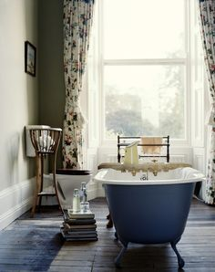 Beautiful - freestanding bath, dark bath, big window (could be French doors) and fireplace. Curtains soften the feel.