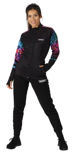 Whether you're running through the woods or warming up at CrossFit, this striking Tikiboo jacket shields you from the wind, showers and cold. Featuring the fabulous Rainboa snake print on a dark base, it's fierce and powerful yet lightweight.  Co-ordinating with our Rainboa leggings and shorts, you can zip in the warmth without overheating. With thumbholes to stop sleeves riding up, the colourful snakeskin print extends across the upper back and down part of the sleeves.