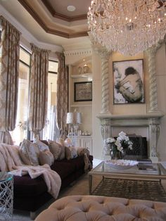 Absolutely beautiful room!! Oversized chandelier, floor-to-ceiling windows, lush draperies....LOVE!