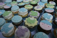 Four dozen cupcakes for a baby shower, lemon with lemon buttercream, chocolate fudge, vanilla with white chocolate frosting and cookies 'n' cream. All fondant detail on top