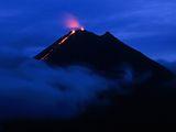 Photo: Lava flowing from dark volcano