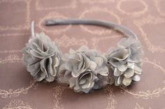 A personal favorite from my Etsy shop https://www.etsy.com/listing/210807740/silver-satin-mesh-headband-grey-vintage