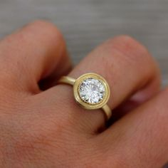 Moissanite and 14k Yellow Gold Engagement Ring, Matte Gold and Textured Bezel, READY TO SHIP Size 7. $2,298.00, via Etsy.