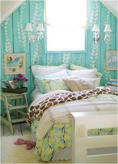 Island inspired beach bungalow bedroom with aqua painted wood wall.