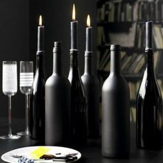 Wine Bottles painted black with black candles are perfect for Halloween. Roll black acrylic paint inside for the shiny type, black matte paint for the exterior.Orange and black candles for halloween, red / green Christmas. Halloween Rose, Table Halloween, Adult Halloween Party, Halloween Dinner, Halloween Crafts, Halloween Mantel, Halloween Mural, Classy Halloween, Halloween Signs