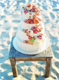 garden rose topped wedding cake