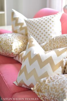 gold pillows, pink couch
