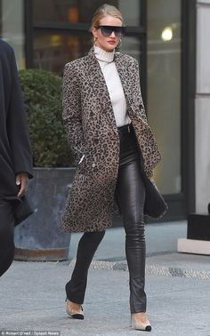 Leggy lady: The model showed off her enviably slender figure in the leather strides, which...