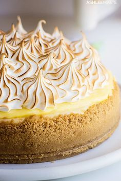 A recipe and video for the perfect lemon meringue cheesecake - a lemon cookie crust a creamy cheesecake with ribbons of fresh lemon curd covered with more tart lemon curd and topped with a fluffy toasted meringue Summer Holiday Spring Lemon Cheesecake Mini Lemon Meringue Pies, No Bake Lemon Cheesecake, Cheesecake Recipes, Lemon Curd Pie, Lemon Curd Dessert, Classic Cheesecake, Homemade Cheesecake, Easy Pie Recipes, Lemon Recipes
