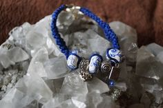 This is a Beautiful Blue Hemp Fashion Bracelet with 3 ceramic beads and Cha