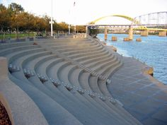 Riverfront Park - OH | Located along the Ohio River and adjacent to the Public Landing, where the first settlers of Cincinnati arrived, this waterfront park, completed for the Bicentennial was designed by landscape architect Robert Zion of the firm Zion & Breen Associates. The resulting Modernist landscape features a 25-foot high serpentine embankment of concrete stadium seating. Learn more at http://tclf.org/landscapes/riverfront-park-oh