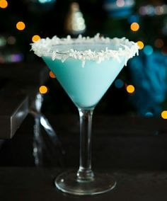Snowball Martini 2 ounces vanilla vodka (Stolichnaya) 2 ounces Malibu rum 2 ounces Coco Lopez 1/4 ounce blue curacao Rim a martini glass with honey and fresh shredded coconut. Shake well and pour into a martini glass.