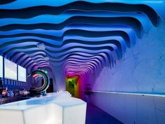 É Pra Poncha Bar by António Fernandez  Nightclub Inspired by Fire and Ice  A Portuguese nightclub resembles a multi-coloured cavern, complete with chameleonic stalactites that undulate from the ceiling.