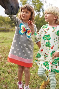 We're dotty about this dress. Made from soft jersey, it is ideal for everyday wear, while the colourblock hem and keyhole back make it special enough for birthday parties. The felt appliqué is both playful and sweet – which just so happens to be our favourite combination.