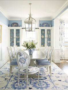 """This blue and white dining room by Patterson Disston Architects just dropped my jaw! It's feminine and with the timeless, classic blue & white motif that we love! Chair Fabrics: Linen is """"Sky Blue"""" from Jane Churchill and the floral, """"Roslyn"""" from """"Sanderson"""". The rug by Custom Cool Rugs in the Hamptons. Paint Color is Benjamin Moore Serenata AF-535. See more: http://www.sarahsarna.com/austin-patterson-disston-architects/"""