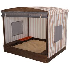 A STYLISH COVERED SANDBOX This Attractive Cabana Sandbox lets kids go on all kinds of wonderful adventures without even leaving the backyard. The roll-up cover, with mesh windows, is perfect for days