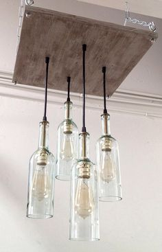 Recycled Wine Bottle Chandelier: Industrial Chandelier, Cottage Chic Lighting, Industrial Lighting, Modern Lighting, Mid-Century Decor by IndustrialLightworks on Etsy https://www.etsy.com/listing/162538528/recycled-wine-bottle-chandelier
