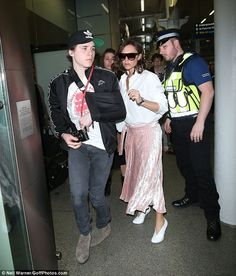 Back in London: Victoria Beckham and her son Brooklyn arrived back in the UK following their whirlwind visit to Paris