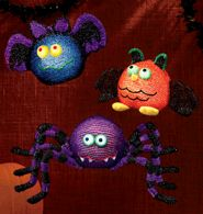 """Halloween Light Up Critters  Avon exclusive. The soft glow of LED lights changes between green, red, blue and magenta. Uses 3 AAA batteries (not included). 4"""" H - 5 1/4"""" H x 9"""" W - 18"""" W. Polyester. Imported.     For decorative use only. This is not a toy. Keep out of reach of children."""
