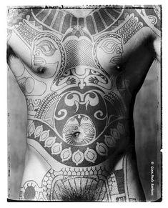 Polynesian tattoo, the belly button is not centered.. not tattooist fault, it just ain't lined up :)