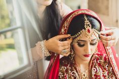 An Asian Indian bride gets ready for her wedding at Hedsor House -photo by tobiah tayo photography - available for commissions worldwide
