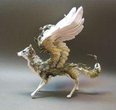 Angel wolf.  www.facebook.com/SheranMattsonPsyd