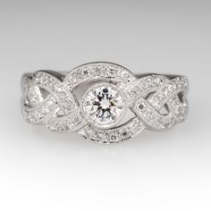 This lovely platinum band features a braided design to accent the F / VVS2 round brilliant diamond that is bezel set at the center of the ring.  The entire face of the ring sparkles with the slightest movement of the wearers hand.  It is currently a size 5 with a design that can easily be sized larger or smaller to fit.