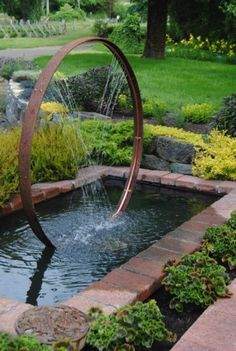 Outdoor Fountains And Water FeaturesYou can find Water features in the garden and more on our website.Outdoor Fountains And Water Features Outdoor Water Features, Water Features In The Garden, Garden Features, Wall Water Features, Wine Barrel Rings, Wine Barrels, Backyard Water Feature, Backyard Ponds, Backyard Waterfalls