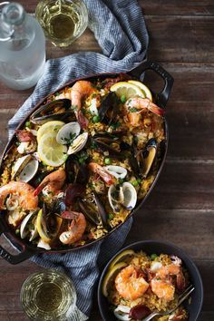 seafood and chorizo paella cooking with cocktail rings