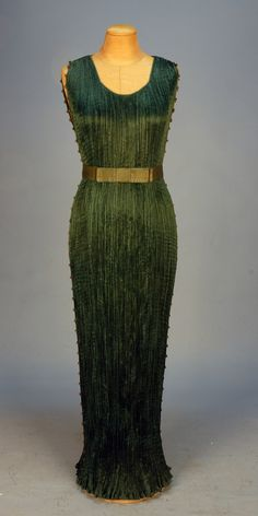 """FORTUNY DELPHOS GOWN and BELT with ORIGINAL BOX, c. 1920. Sleeveless spruce silk having fixed gently scooped neckline, white and amber Murano glass beads on silk cord decorating the armholes and side seams, gold stencilled silk belt with bow over hook & eye closures, selvedge stamped """"Fabrique en Italie . Fortuny Depose"""""""