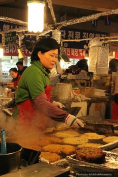 Yummy bindaetteok on the griddle at Gwangjang Market in Seoul!