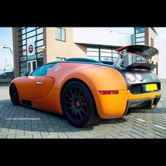 Beautiful orand and black Bugatti Veyron Rear shot!