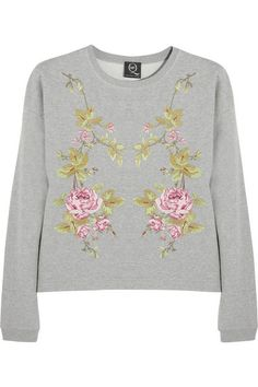 McQ Alexander McQueen's boxy sweatshirt is embroidered with mirrored rose motifs. Dropped shoulders add to its insouciant appeal, while the looped terry interior ensures a comfortable fit. Wear this cotton-jersey piece with skinny jeans.