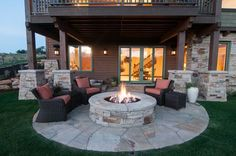 Curved patio for seating and fire pit in front of the 2nd story deck