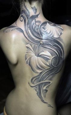 Soft silver color flower tattoo on full back