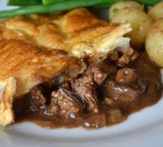 beef dishes This is an indulgent and warming pie full of lovely rich flavors; this beef, Stilton and Guinness pie is perfect anytime and makes a great change to the standard beef pie with Irish Recipes, Beef Recipes, Cooking Recipes, English Recipes, Chicken Recipes, Beef And Guinness Pie, Guinness Recipes, Steak And Ale, Beef Pies