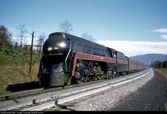 J 603 rolls downgrade with a complete streamlined set of equipment on the POWHATAN ARROW bound for Cincinnati. This is the 4-8-4 featured in O. Winston Link's long recording of train 42 at Rural Retreat, Va. on Christmas Eve 1957.
