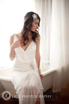 erin cole, bridal, hair accessory, bracelet, v neck wedding dress, hair pin, curly brown hair, wedding hair and makeup, lace and tulle wedding dress, bridal poses