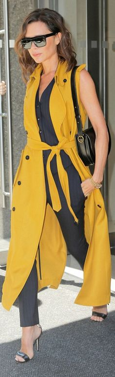 Victoria Beckham: Coat, sunglasses, and purse – Victoria Beckham Collection Shoes – Manolo Blahnik