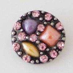 $2.25 - KB7942 Purple Cream & Peach Set in Black and Surrounded by Small Pink Crystals