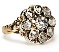Glorious Georgian Diamond Cluster Ring.  A flowerhead cluster of nine (9) hand cut rose cut diamonds foiled and set closed back in silver over 14k yellow gold in the typical period fashion.  1.10 carats.