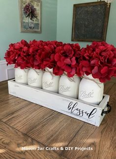 Vintage Decor Diy Blessed Mason Jar Table Decor - Looking to add a pop of color to your space? This mason jar centerpiece will do the trick! It has subtle and beautiful cream jars, distressed cream box, and gorgeous deep red hydrangeas. Pot Mason Diy, Mason Jar Crafts, Decoration St Valentin, Do It Yourself Decoration, Mason Jar Centerpieces, Red Mason Jars, Rustic Mason Jars, Everyday Table Centerpieces, Wedding Centerpieces