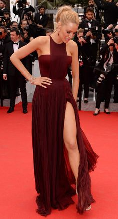 Blake Lively - Blake Lively works the left leg glamour in Gucci premiere gown. The two tone bordeaux silk chiffon dress features a pleated skirt, fitted bodice and a geometric neckline.