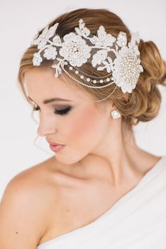 Gabrielle Bridal Headpiece -  A striking, statement headpiece for a glamorous bride, featuring diamonte and pearl details, with cascading chains attached to a filigree lace base. #BridalHeadpiece #WeddingHeadpiece #Bride #WeddingHair